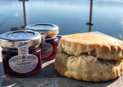 Scone and jam overlooking the lake at Berts, Dacre Park, Brandesburton